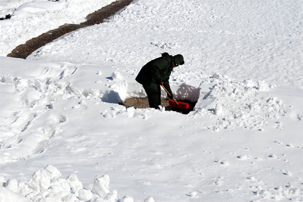 Man digging snow using the best snow shovel